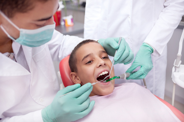Little boy sitting in the dentists office
